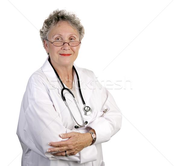зрелый женщины врач компетентный глядя изолированный Сток-фото © lisafx