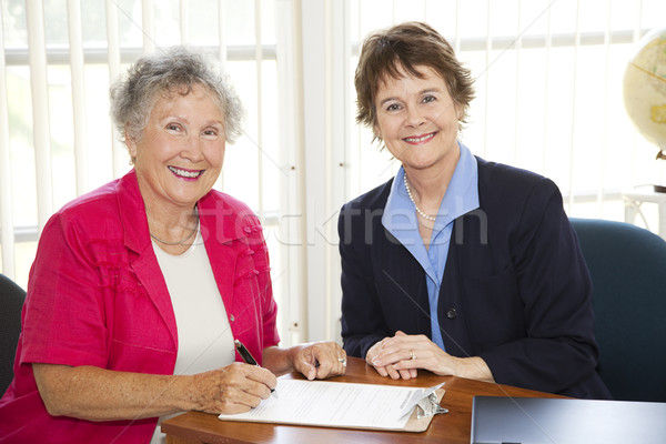 Senior Woman Signing Paperwork Stock photo © lisafx