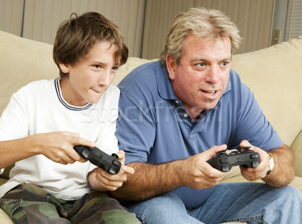 Video amca baba oğul oynama video oyunları birlikte Stok fotoğraf © lisafx
