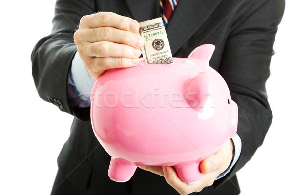 Businessman Saving Money Stock photo © lisafx
