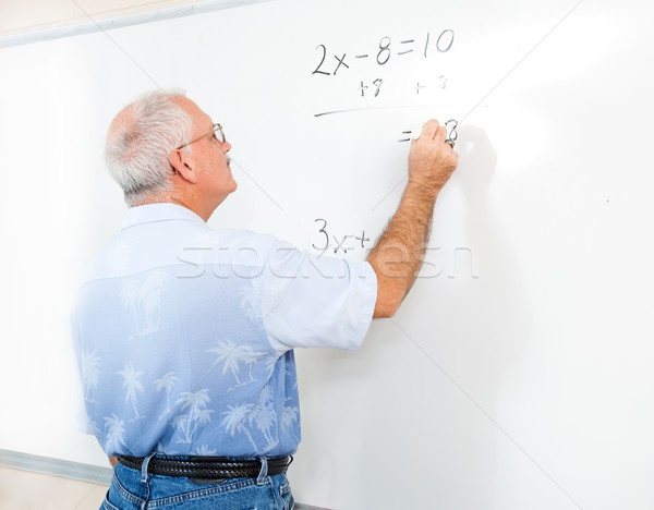 Stock Photo of Teacher or Adult Student at Blackboard Stock photo © lisafx