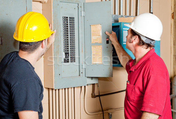 Repairmen Examine Electrical Panel Stock photo © lisafx