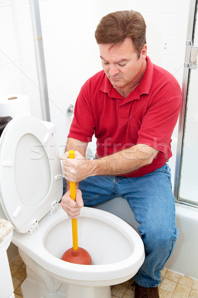 Man Uses Plunger on Clogged Toilet Stock photo © lisafx