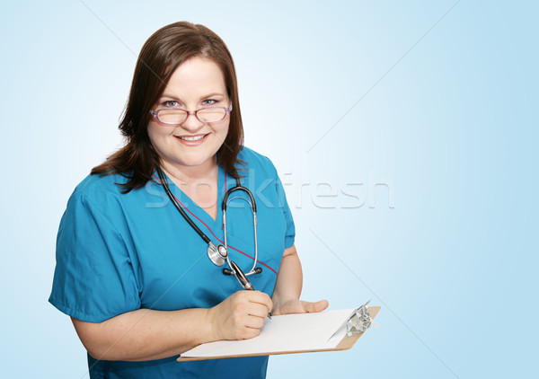Nurse With Clipboard on Blue Stock photo © lisafx