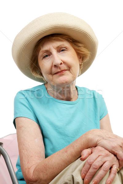 Praia senior melancolia mulher chapéu de palha olhando Foto stock © lisafx