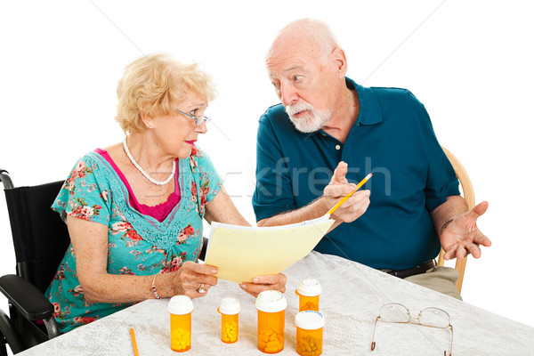 Senior Couple Discussing Medical Expenses Stock photo © lisafx