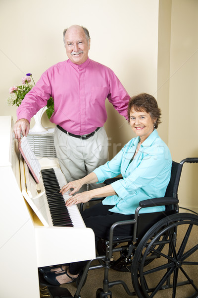 Stock photo: Church Pianist in Wheelchair