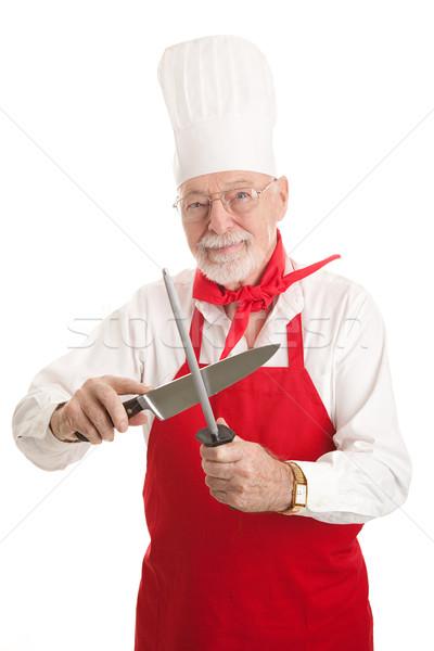 Mature Chef Sharpens Knife Stock photo © lisafx