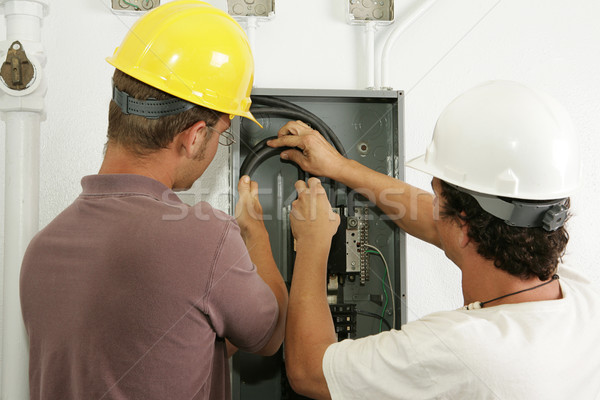 Electricians Install Panel Stock photo © lisafx