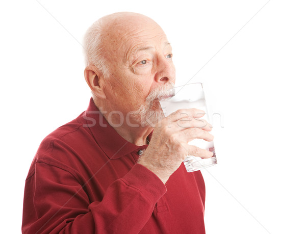 Susuzluk su kıdemli adam büyük cam Stok fotoğraf © lisafx
