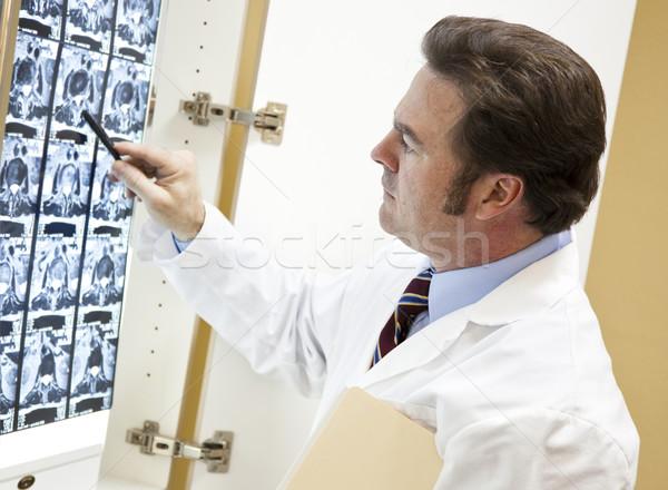Kręgarz skanować pracy czytania osoby mężczyzna Zdjęcia stock © lisafx