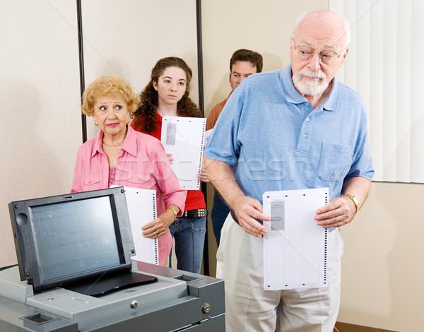 Confuso senior eleitor homem novo ótico Foto stock © lisafx