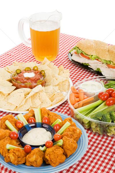 Partij levensmiddelen verticaal tabel ingesteld partij snack Stockfoto © lisafx
