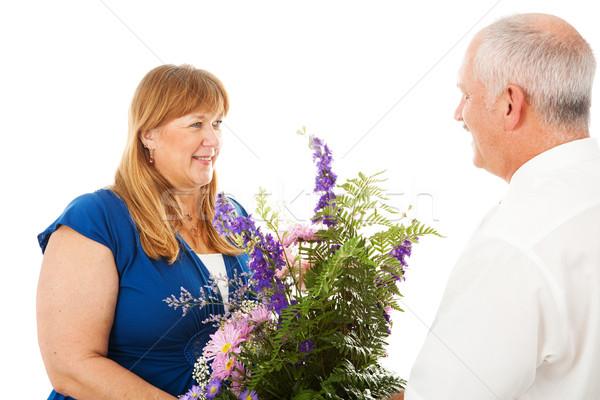 Bloemen gelukkig vrouw gewijd echtgenoot geïsoleerd Stockfoto © lisafx
