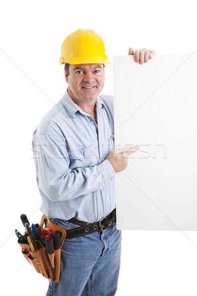Bouwvakker punten teken wijzend witte geïsoleerd Stockfoto © lisafx