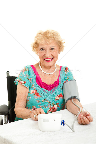 Woman Taking Her Own Blood Pressure Stock photo © lisafx
