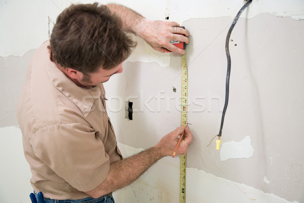 Worker Measuring and Marking Stock photo © lisafx