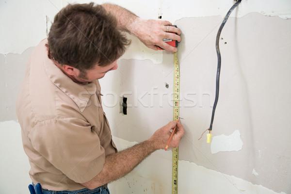 Werknemer gipsplaten opening Stockfoto © lisafx