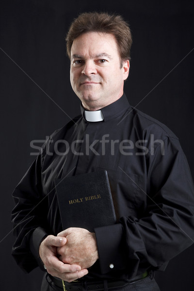 Solemn Priest With Bible Stock photo © lisafx