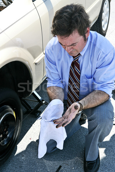 Flat Tire - Dirty Hands Stock photo © lisafx