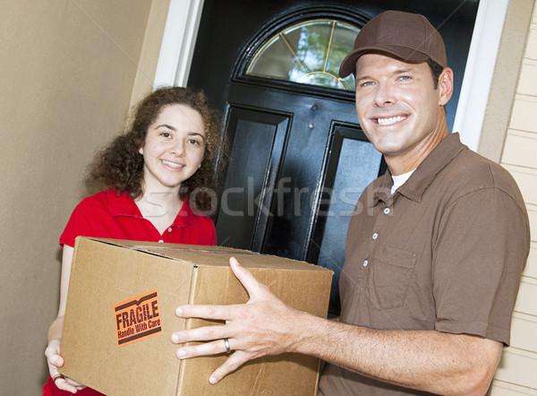 Accueillant livraison Guy client paquet Photo stock © lisafx