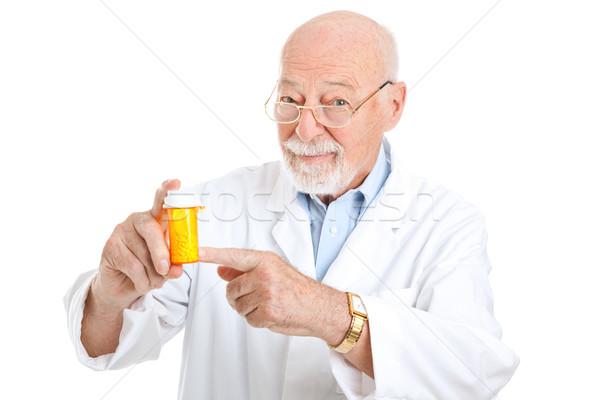 Gyógyszerész javaslat érett különleges gyógyszer izolált Stock fotó © lisafx