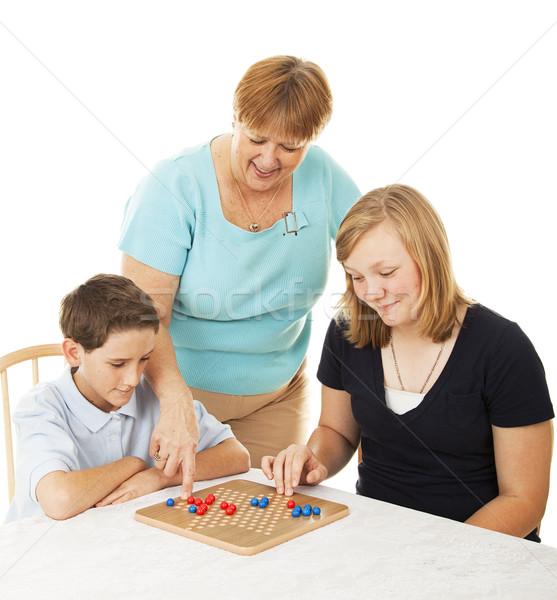 Család társasjáték anya anya kettő gyerekek Stock fotó © lisafx