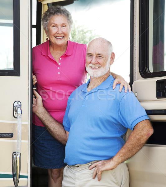 Idősek kapualj idős pár pózol luxus motor Stock fotó © lisafx
