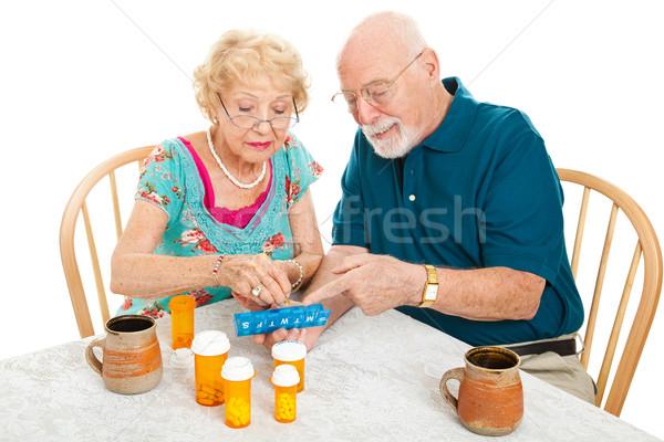 Senior Couple Sorts Medications Stock photo © lisafx