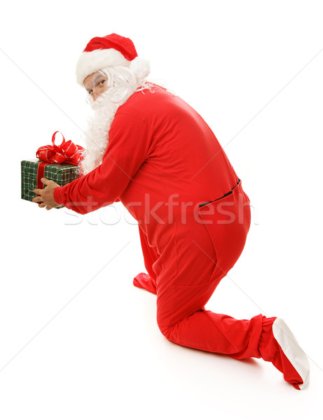 Santa Caught With Gift Stock photo © lisafx