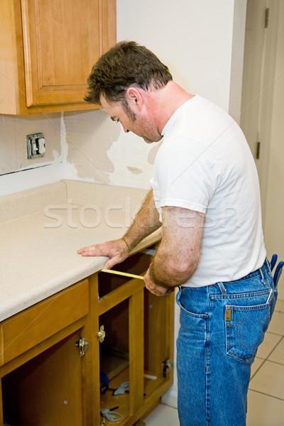 Carpenter Measuring Cabinets Stock photo © lisafx