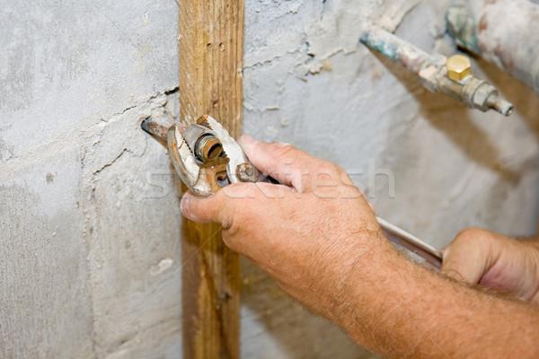 Idraulico dado primo piano idraulici mani acqua Foto d'archivio © lisafx