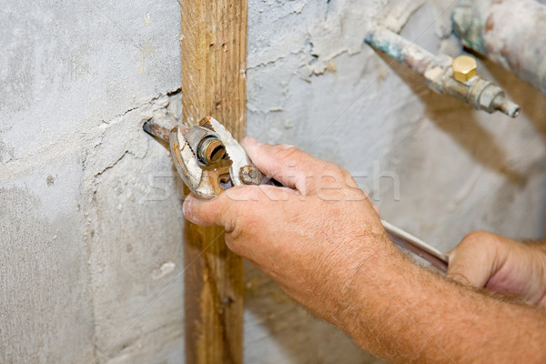 Plumber Tightens Nut Stock photo © lisafx