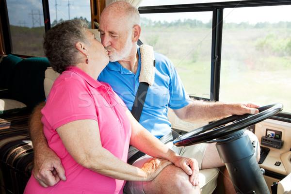 Idősek vezetés vakációzás idős pár csók motor Stock fotó © lisafx