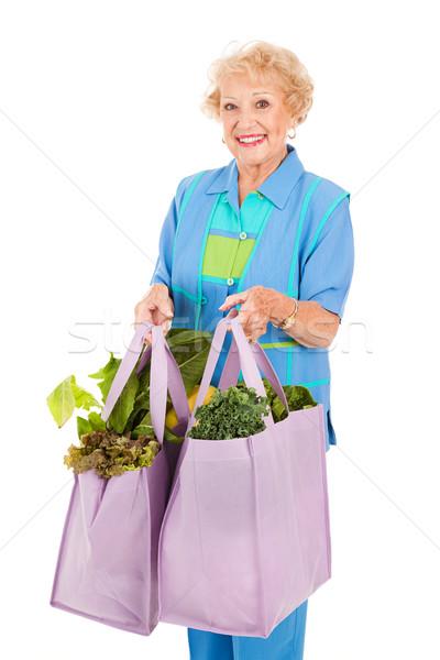 Senior signora negozi verde donna Foto d'archivio © lisafx
