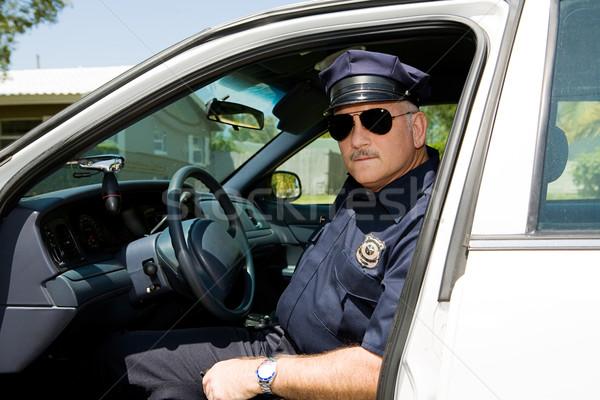 ストックフォト: 警察官 · 義務 · ハンサム · 成熟した · 座って · 道路