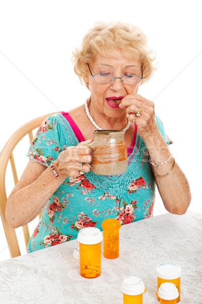 Healthy Senior Woman Takes Medication Stock photo © lisafx