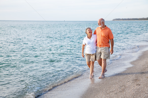 Seniors Walking on the Beach Stock photo © lisafx