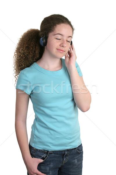 Teen tshirt teen girl słuchanie muzyki słuchawki niebieski Zdjęcia stock © lisafx