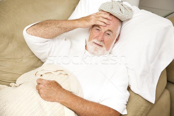 Kac starszy człowiek domu chorych bed Zdjęcia stock © lisafx