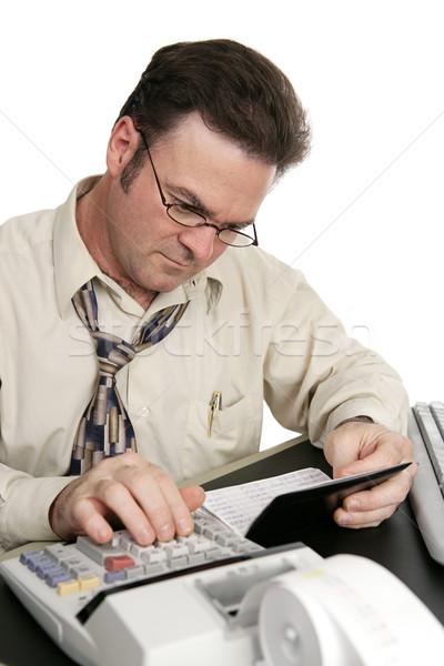Dengeleme çek defteri hesap makinesi adam dengelemek yalıtılmış Stok fotoğraf © lisafx