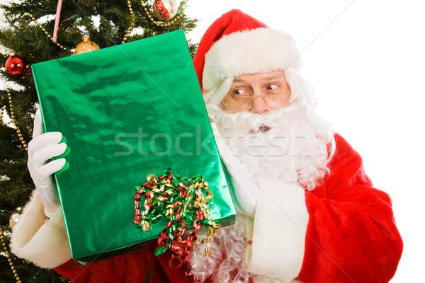 Ciekawy christmas Święty mikołaj Święty mikołaj obecnej odgadnąć Zdjęcia stock © lisafx