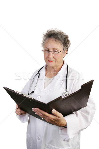 Mature Female Doctor Reviewing Chart Stock photo © lisafx