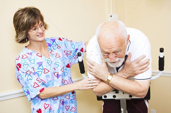 Stock photo: Physical Therapist Works with Senior