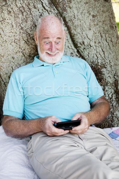 Szöveges üzenet megrémült idős férfi szexi technológia Stock fotó © lisafx