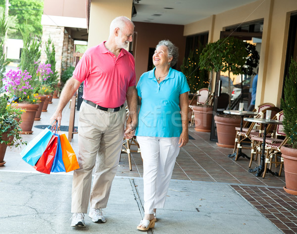 Stock photo: Shopping Seniors - Carrying Her Bags
