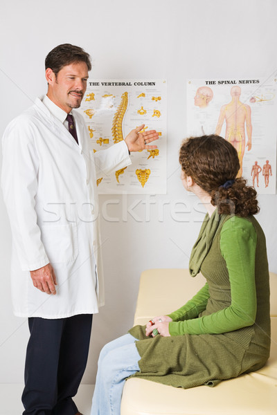 Chiropractor Explains Spinal Column Stock photo © lisafx