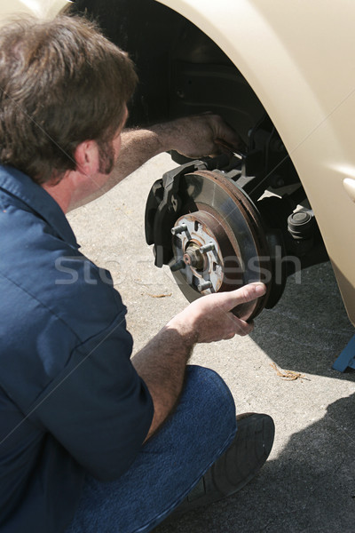 Stock photo: Mechanic Adjusting Brakes