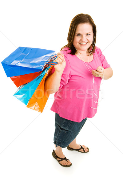 Shopping with MP3 PLayer Stock photo © lisafx