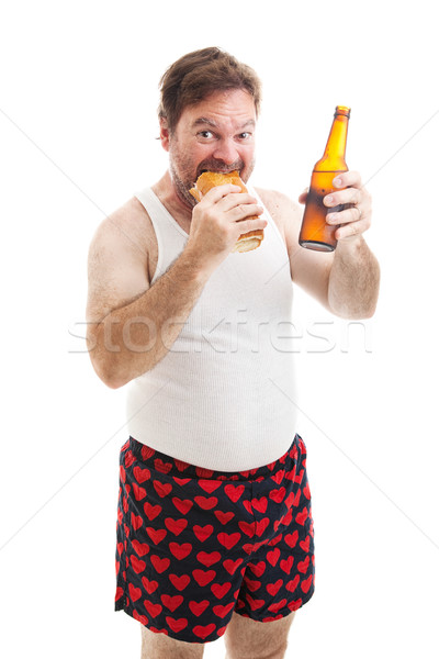 Scruffy Man Eats Sub Sandwich Stock photo © lisafx